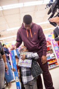 Andre Johnson takes children from Child Protective Services on a shopping spree. Photo Credit: Micahl Wyckoff